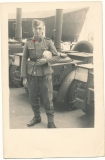 Waffen SS man in front of field kitchen cookhouse