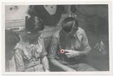 U 129 Mechanikermaat Karl Donsbach mit Frontfertigung vom Deutschen Kreuz in Gold in der Offiziersmesse vom U Boot 1942