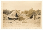 Africa corps DAK soldier with sewing machine in front of tent